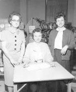 Dorothy Streeter (center) in the bookstore when it was located where the Jane Schultz room now is.